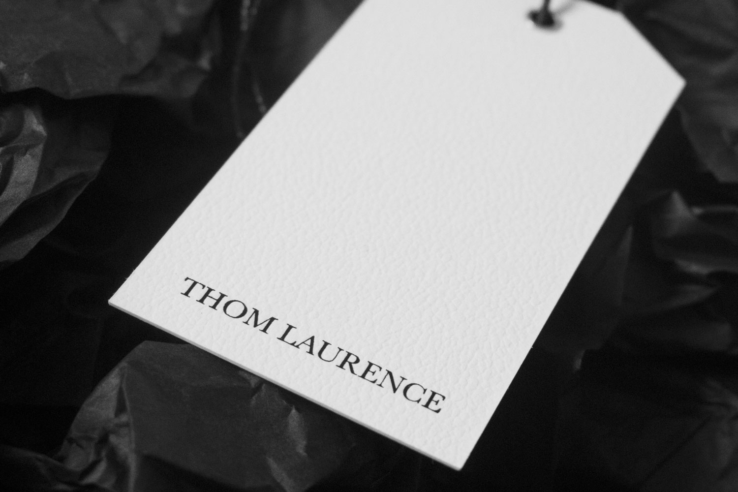 Progress Packaging Thom Laurence Bespoke Luxury Colorplan Embossed Blackfoil Box Manufacture Production Print Tissue Swing Tag